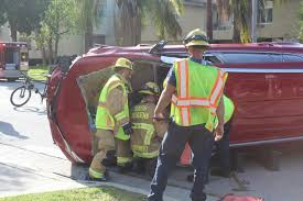 photo bill glazier southpasadenan fire department officials cut out a windshield of a vehicle before pulling out man who was trapped inside