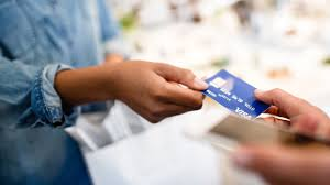 person handing card to another person
