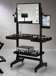 black lighted makeup table with mirror ans wheel placed on white ceramick tiled floor