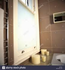 Scented Candles Below Sash Window With Opaque Glass In Modern - Candles for bathroom
