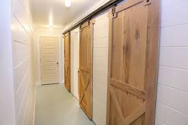 2 barn doors on one wall for multiple rooms