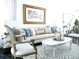 gray zebra rug this gray living room uses a fantastic zebra rug to give it an gray zebra rug best red and white