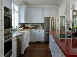 white kitchen with red countertop