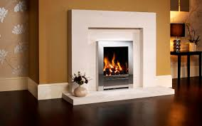 excellent napoleon fireplace with silver frame and white mantel kit on tan wall matched with wooden