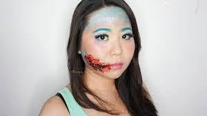 easy inspired look mermaid with torn lips special effect and face painting makeup tutorial