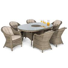 Maze rattan winchester 6 seater oval outdoor dining set with parasol and ice bucket robert dyas