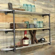 we also made this shelf with galvanized pipes last year in the garage ditpipeshelf