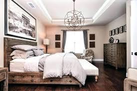 chandelier over master bed chandelier over bed traditional master bedroom with crown molding chandelier in chandelier