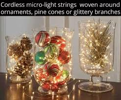 Light Up Vases With Fairy Lights And Ornaments Or Pinecones
