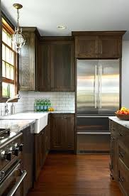 dark stained kitchen cabinets. Design Group Desire To Inspire Dark Stain Kitchen Cabinet Refinishing Oak Cabinets . Staining Stained