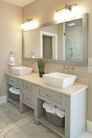 overhead bathroom lighting. really nice vanity and basins matched well with the long mirror overhead lighting 2010 bathroom f