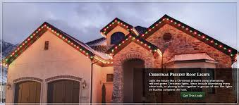 lighting a house. Alternating Red And Green Themed Roof Lights Lighting A House