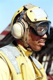 US Navy Aviation Boatswain's Mate (Handler) Air Warfare Byron Coleman  awaits his next customer during cyclic