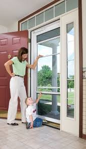 spectrum storm doors are functional beautiful and durable plus provia s retractable screens allow for more venting than ever
