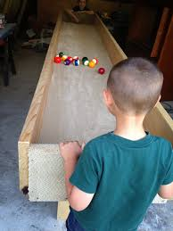 carpet ball. my 4 year old stood on a stool to play. carpet ball