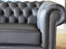 modern handmade deep oned black clarendon leather chesterfield sofa close up