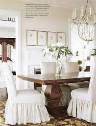 beautiful table ruffled slips and chandelier love the ivory walls with white trim