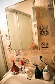 bathroom wallpapered in alice in wonderland book pages aliceinwonderland bookpagewallpaper
