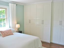 wood sliding closet doors. White Wooden Sliding Closet Doors With Silver Steel Handlers Placed On The Blue Wall And Brown Wood