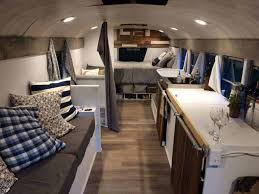 this bus rv conversion has a sleek modern look with couches beds a