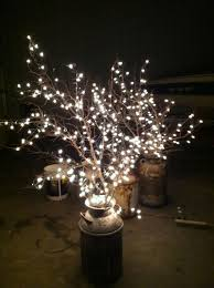 wedding lighting use old milk cans branches and white lights