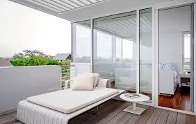 balcony design furniture. Furniture:Minimalist Balcony Design With White Minimalist Deck Feat Cushions Near Round Furniture H