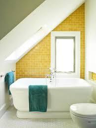 yellow tiled angled bathroom wall with hexagonal floors