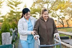 Homecare Nurse Helps Senior Citizen Patient Exercise Stocksy United