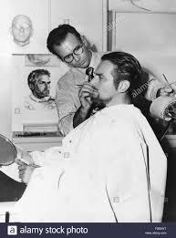 makeup artist ben nye working on actor douglas fairbanks jr ca 1940s csu20168487