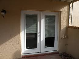 interior horizontal stripped blind sliding glass door with white wooden frame placed on the cream