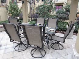 patio set with swivel chairs swivel patio chairs table chair pool vase flower