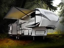 2019 forest river impression 28bhs fifth wheel parked in the woods
