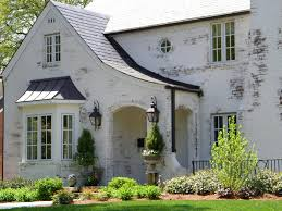 painted brick house in white