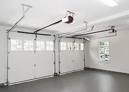 two garage door openers inside of a garage