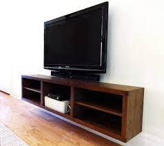 Walnut entrance cabinet and floating t.v. console modern-living-room