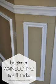 installing trim wainscoting such as a chair rail or shadow box molding instantly updates