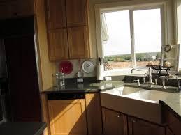white double corner kitchen sink on soapstone countertop perfect for small kitchen