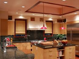 red hang lamp kitchen exposed brick wall white shelves with wooden cabinet on the wooden floor