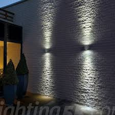 flush outdoor wall lights are perfect to go on the big empty wall this will add some interesting pattern accentuate the height of the building as well as