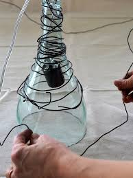 How To Make Pendant Lights From Wine Bottles Upcycle Wine Bottle Into Pendant Light Fixtures How Tos Diy