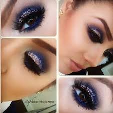 for nye to match royal blue dress smokey eye with glitter glitter eye