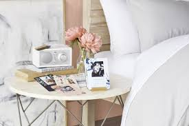 use pops of color on your bedside table to add personality to the room fresh flowers and personalized easel calendars are a great way to alternate colors