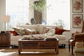 pottery barn this living room uses a reclaimed wood coffee table that is part of the