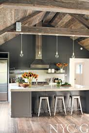 this kitchen is the faux beams dream the rustic wooden beams across the ceiling and