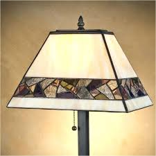 stained glass the j mosaic design stained glass table lamp has tapered rectangular multiple ivory stained glass panes accented with multi colored