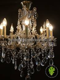 pair of italian marie therese chandeliers with a bird cage style glass covered frame