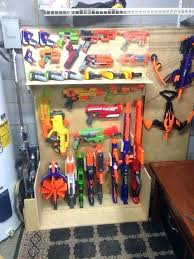 Attach 2 hooks spaced about the same length as your nerf gun for each gun you want to store and hang them over the hooks for quick, efficient storage. Pin On Toy Organization