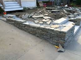 installing stone walls granite steps and bluestone patio