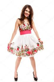 cute young woman in summer dress on