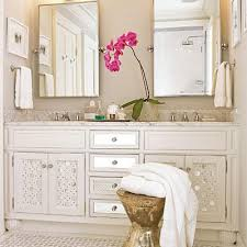 Heather Chadduck - Gorgeous beachy bathroom design with white mirrored  bathroom vanity, double sinks, pivot mirrors, calcutta gold marble  countertops, ...